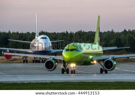 Moscow region, Domodedovo, Russia - August 18, 2013: Airbus A320 S7 - Siberia Airlines taxiing for take off and Boeing 747-400 Transaero airlines behind of him at Domodedovo international airport - stock photo