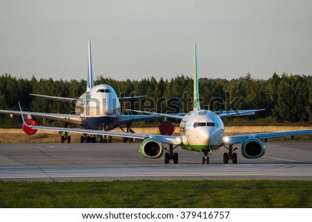 Moscow region, Domodedovo, Russia - August 18, 2013: Boeing 737-800 S7 - Siberia airlines VP-BDF in special OneWorld livery and Boeing 747 Transaero behind of him at Domodedovo international airport - stock photo