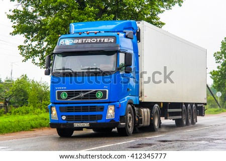 MOSCOW REGION, RUSSIA - MAY 22, 2013: Semi-trailer truck Volvo FH12 at the interurban road. - stock photo