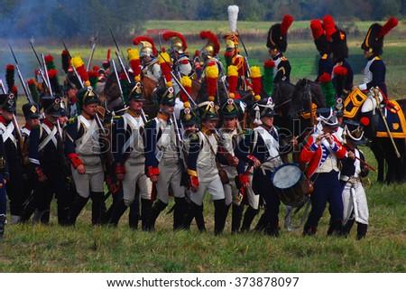 MOSCOW REGION - SEPTEMBER 07, 2014: Reenactors dressed as Napoleonic war soldiers at Borodino battle historical reenactment. - stock photo