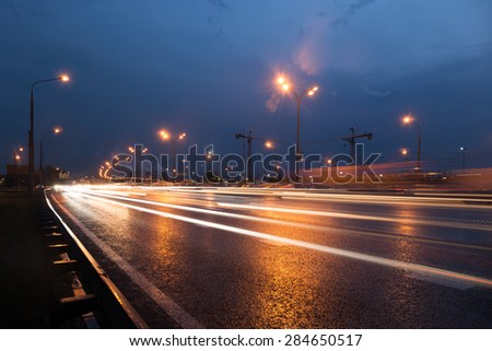 Moscow Ring Road at evening with light trails - stock photo