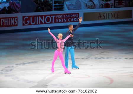 "MOSCOW, RUSSIA - APR 28: Aliona Savchenko and Robin Szolkowy win the pair figure skating event at the 2011 World Championship Figure Skating at the Palace of Sports ""Megasport"" on April 28, 2011 in Moscow, Russia. - stock photo"