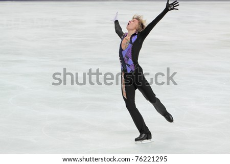 """MOSCOW, RUSSIA - APR 28: World championship on figure skating 2011. Artur Gachinski - performance of the bronze medallist in single man's figure skating. """"Megasport"""" on April 28, 2011 in Moscow - stock photo"""