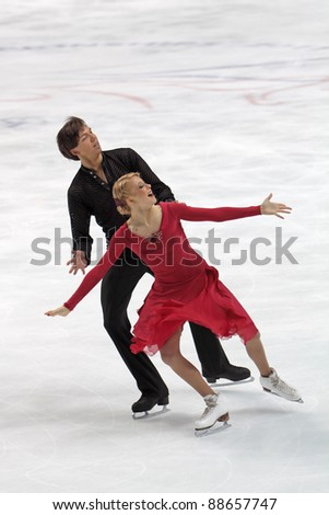"MOSCOW, RUSSIA - APR 30: World championship on figure skating 2011. Ekaterina Bobrova and Dmitri Soloviev in pair ice dance. Palace of sports ""Megasport"" on April 30, 2011 in Moscow. - stock photo"