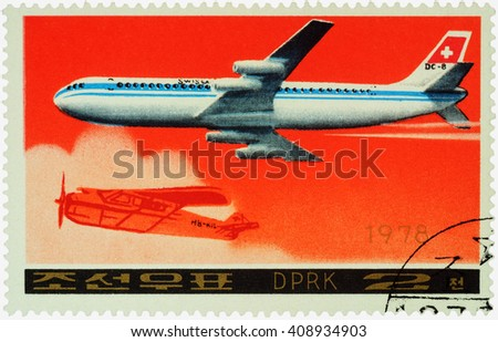 "MOSCOW, RUSSIA - APRIL 10, 2016: A stamp printed in DPRK (North Korea) shows American passenger aircraft Douglas DC-8-53 and old airplane, series ""Airplanes"", circa 1978 - stock photo"