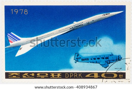 "MOSCOW, RUSSIA - APRIL 09, 2016: A stamp printed in DPRK (North Korea) shows Anglo-French supersonic passenger aircraft Concorde and old airplane, series ""Airplanes"", circa 1978 - stock photo"