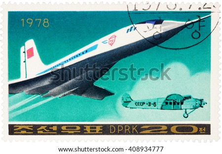 "MOSCOW, RUSSIA - APRIL 09, 2016: A stamp printed in DPRK (North Korea) shows Russian supersonic passenger aircraft Tu 144 and old airplane, series ""Airplanes"", circa 1978 - stock photo"