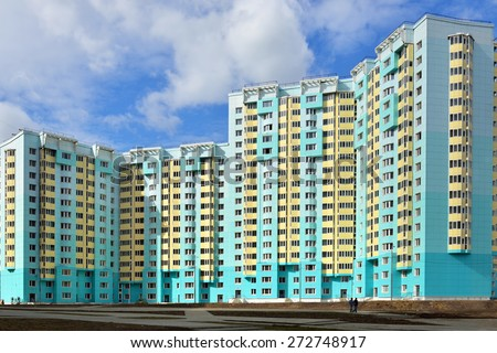 MOSCOW, RUSSIA - APRIL 22, 2015: Facade of new modern high-rise apartment buildings in Moscow on background of blue sky - stock photo
