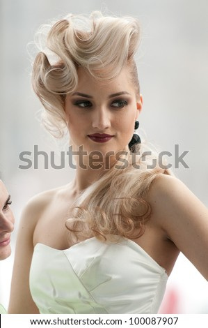 MOSCOW, RUSSIA - APRIL 01: model prepare for the XV Championships of Moscow hairdressing, decorative cosmetics, modeling and nail design on April 01, 2012 in Moscow, Russia. - stock photo