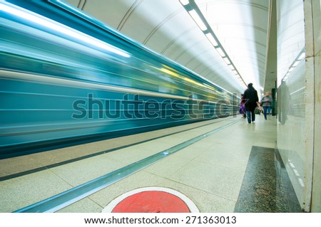 MOSCOW, RUSSIA - APRIL 17, 2015: Moving train and passengers  in subway station Mendeleevskaya in Moscow, Russia - stock photo