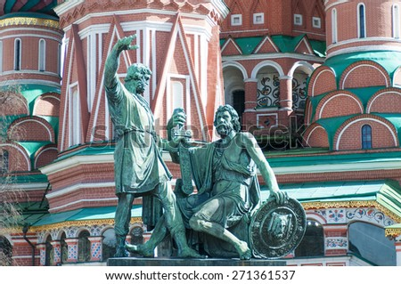 MOSCOW, RUSSIA - APRIL 17, 2015: Saint Basil Church and Minin and Pozharsky Monument at Red Square in Moscow; Russia - stock photo