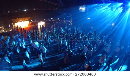 MOSCOW, RUSSIA - APRIL 5, 2014: Trance festival TRANSMISSION in a nightclub Stadium Live, aerial view. This festival is held for more than 10 years - stock photo