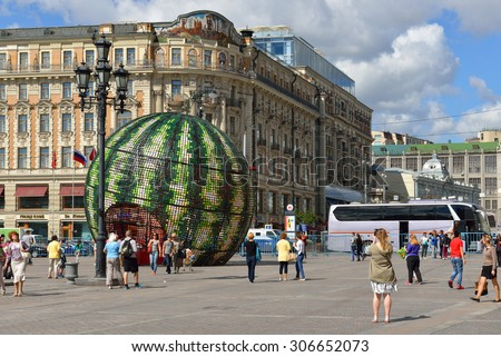 MOSCOW, RUSSIA - AUG 14,2015:Holiday jam marks start of harvest time in middle Russia.17000 plants will be used to adorn holiday. In 2015 main art object is 11-m watermelon light ball on Manezh Square - stock photo