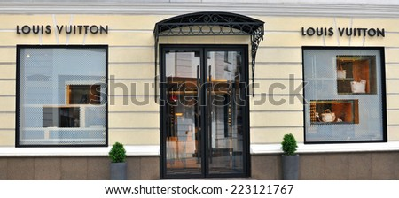 MOSCOW, RUSSIA - AUGUST 30: Facade of Louis Vuitton store in Moscow on August 30, 2014. Louis Vuitton is a famous high fashion house founded in France.  - stock photo