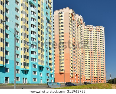 MOSCOW, RUSSIA - AUGUST 28, 2015:  Facade of new modern high-rise apartment buildings in Moscow on background of blue sky - stock photo