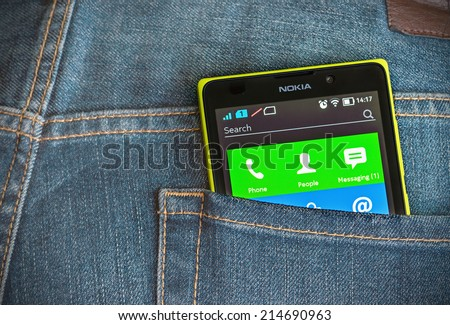 Moscow, Russia - August 26, 2014: Nokia XL smartphone in the pocket of jeans. Nokia XL new smartphone running on the Android platform with a 2-core processor Qualcomm.  - stock photo