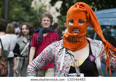 MOSCOW , RUSSIA - AUGUST 17. Protestant wears orange balaclava Pussy Riot  outside court to protest against  verdict and support the members of  Pussy Riot feminist punk band on August 17, 2012, Moscow - stock photo