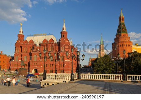 Moscow, Russia - August 18, 2013: The State Historical Museum on Red Square, landmark on the square in front of the museum walk men, women and children - stock photo