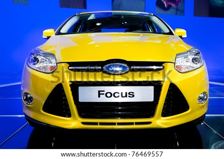 MOSCOW, RUSSIA - AUGUST 25:  Yellow car Ford Focus on display at Moscow International exhibition InterAuto on August 25, 2010 in Moscow, Russia. - stock photo