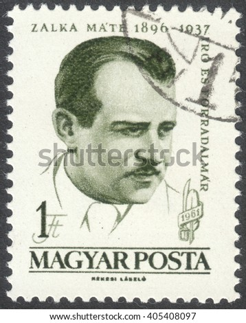 MOSCOW, RUSSIA - CIRCA APRIL, 2016: a post stamp printed in HUNGARY shows a portrait of Mate Zalka, dedicated to the 65th Anniversary of the Birth of Mate Zalka, circa 1961 - stock photo