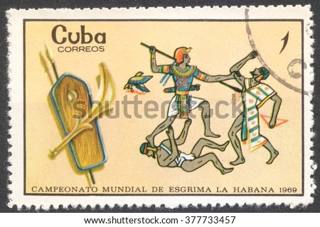 "MOSCOW, RUSSIA - CIRCA FEBRUARY, 2016: a post stamp printed in CUBA shows Egyptian warriors, the series ""World Fencing Championships, Havana"", circa 1969 - stock photo"