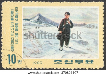 "MOSCOW, RUSSIA - CIRCA FEBRUARY, 2016: a post stamp printed in the NORTH KOREA, the series ""The 57th Anniversary of the Birth of Kim Il Sung, Pictures from his Youth"", circa 1969 - stock photo"