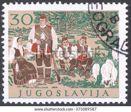 "MOSCOW, RUSSIA - CIRCA FEBRUARY, 2016: a post stamp printed in YUGOSLAVIA shows traditional costumes, the series ""Regional Costumes"", circa 1957 - stock photo"