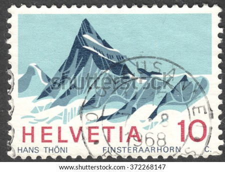 """MOSCOW, RUSSIA - CIRCA JANUARY, 2016: a post stamp printed in SWITZERLAND shows Finsteraarhorn mountain, the series """"Swiss Alps"""", circa 1966 - stock photo"""