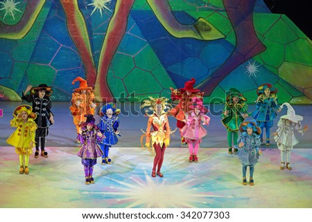 MOSCOW, RUSSIA - DEC 27, 2014: Children's Christmas show in State Kremlin Palace in Moscow Kremlin. The actors on the stage - stock photo