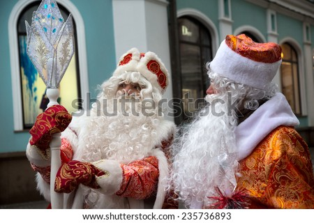 MOSCOW, RUSSIA - DEC 22: Russian Christmas characters Ded Moroz (Father Frost) disscusing a magic staff during Ded Moroz parade on central Moscow street on 22 of December 2013, Russia - stock photo