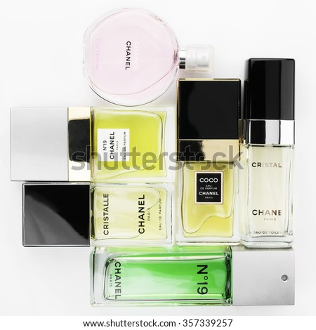 Moscow, Russia - December 14, 2015: Chanel perfume set lying on white background: â??19 and Cristalle in different concentrations, Coco, Chance Tendre. Top view point. - stock photo