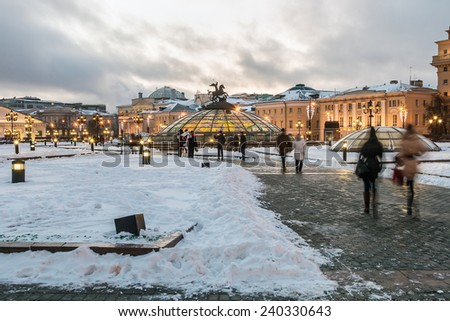 Moscow, Russia - December 27, 2014: evening view of the evening view of the Manezhnaya square  in Moscow in the winter. Manezhnaya square and the monument to Saint George. St. George. - stock photo
