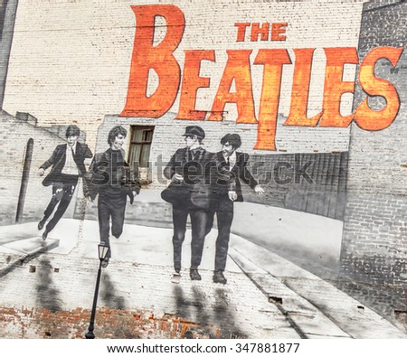 MOSCOW, RUSSIA - DECEMBER 5, 2015: The Beatles graffiti on the wall in Moscow. Mytnaya street. - stock photo