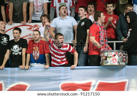 MOSCOW, RUSSIA - DECEMBER 14: Unidentified fans in action a European League woman's volleyball game Dynamo Russia (blue) vs Crvena Zvezda Belgrade (Serbia) on December 14, 2011 in Moscow, Russia. - stock photo