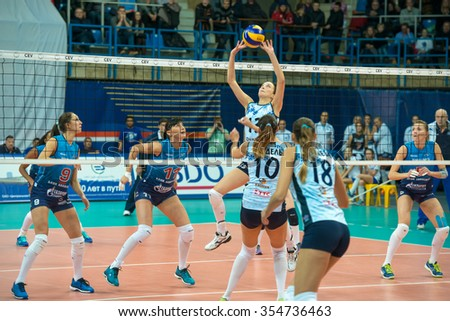 MOSCOW, RUSSIA - DECEMBER 2, 2015: Unidentified players in action during the game on women's Rissian volleyball Championship game Dynamo (MSC) vs Dynamo (KZN) at the Luzhniki stadium in Moscow, Russia - stock photo