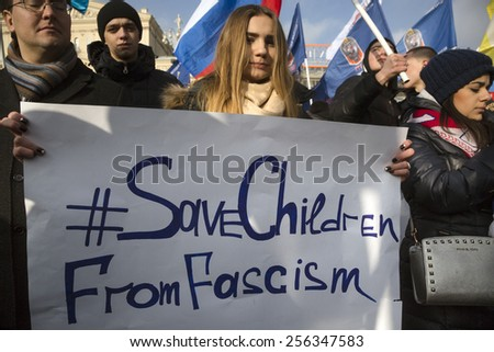MOSCOW,RUSSIA - FEB 21: Pro-Kremlin activists from Russia's Anti-Maidan movement marched with banners in center of Moscow to mark the one year anniversary of Ukraine's pro-EU protests on 21 of Feb 2015 - stock photo