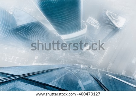 MOSCOW, RUSSIA - FEB 23, 2014: Skyscrapers of Moscow City business complex during snowfall. Moscow International Business Center Moscow City includes 20 futuristic buildings - stock photo