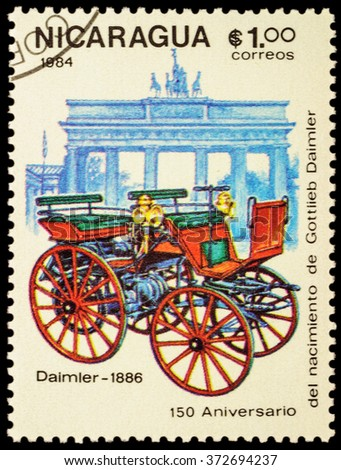 """MOSCOW, RUSSIA - FEBRUARY 06, 2016: A stamp printed in Nicaragua shows first car Daimler (1886), series """"The 150th Anniversary of the Birth of Gottlieb Daimler, 1834-1900 - Vintage Cars"""", circa 1984 - stock photo"""
