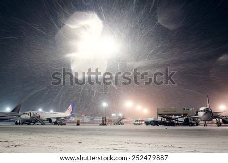 Moscow, Russia, February, 09,2015: airport and planes at non-flying weather, winter time  - stock photo