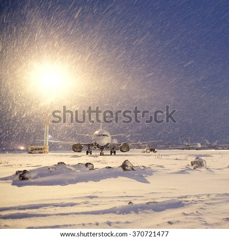 Moscow, Russia, February, 09,2015: commercial airplanes parking at the airport in winter - stock photo