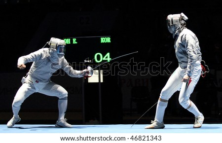 MOSCOW, RUSSIA - FEBRUARY 13: Duel for Cup Grand Prix event, Eun S.Oh (KOR) and Zsolt Nemcsik (HUN) compete at the 2010 RFF Moscow Saber World Fencing Tournament, February 13, 2010 in Moscow, Russia. - stock photo