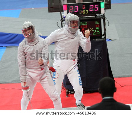 MOSCOW, RUSSIA - FEBRUARY 14: Nikolay Kovalev (RUS) and Aldo Montano (ITA) compete at the 2010 RFF Moscow Saber World Fencing Tournament, February 14, 2010 in Moscow, Russia. - stock photo