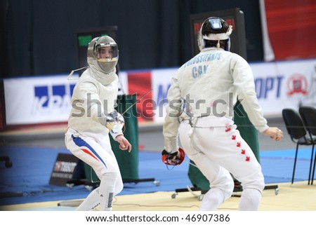 "MOSCOW, RUSSIA - FEBRUARY 14: ""Sabre de Moscou""-2010 Moscow Saber World Fencing Tournament, is a one of the most prestigious international competitions in fencing, February 14, 2010 in Moscow, Russia. - stock photo"