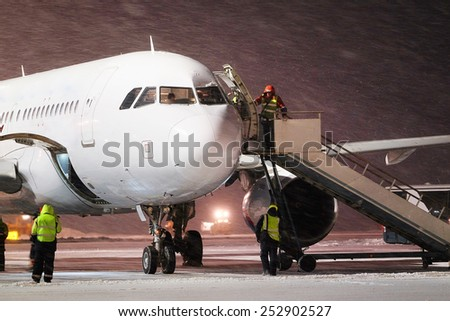 Moscow, Russia, February, 09,2015: serves the ladder to the plane - stock photo