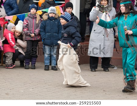 MOSCOW, RUSSIA - FEBRUARY 22: Unidentified kid run in bag on Russian religious and folk holiday Maslenitsa near Culture center Peresvet on February 22, 2015, Russia - stock photo
