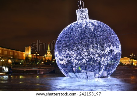 MOSCOW, RUSSIA - JAN 5, 2015:Huge Christmas decoration made of lights was placed on Manezh square in front of Kremlin. Height is 11 m decorations. To decorate it and make shine, it took 9 km garlands - stock photo