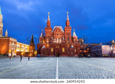 Moscow, Russia - 15 January, 2015: People walking and taking pictures in front of State Historical Museum building on the Red Square, Moscow at January 15, 2015. - stock photo