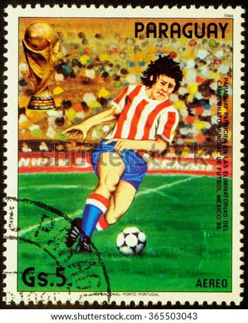 """MOSCOW, RUSSIA - JANUARY 20, 2016: stamp printed in Paraguay shows running football player, series """"Football World Cup - Mexico 1986"""", circa 1984 - stock photo"""