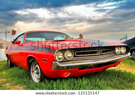MOSCOW, RUSSIA - JULY 6: American muscle car Dodge Challenger exhibited at the annual International Motor show Autoexotica on July 6, 2012 in Moscow, Russia. - stock photo