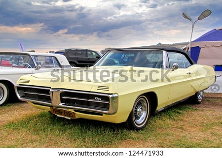 MOSCOW, RUSSIA - JULY 6: American muscle car Pontiac Grand Prix exhibited at the annual International Motor show Autoexotica on July 6, 2012 in Moscow, Russia. - stock photo